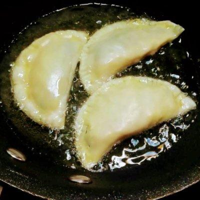 fritura empanadillas lado
